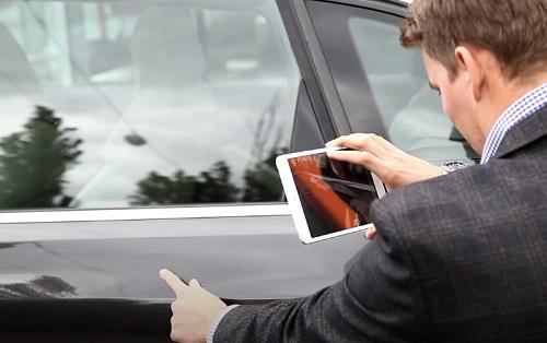 car agent inspecting exteriors
